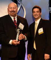 Robert Bennett, CIO of the Federal Home Loan Bank of Atlanta, left, was the winner in the corporate category, shown here with Mike Giglio of Ciber who presented the award.