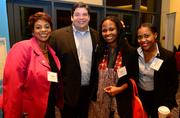 Yolanda Davis,  from left; Jeff Hall, Denise Smith, and Shavika Mac all with Ernst & Young.