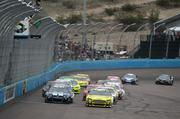 AVONDALE, AZ - MARCH 03:  Carl Edwards, driver of the #99 Subway Ford, leads Jimmie Johnson, driver of the #48 Lowe's Chevrolet, on the final restart during the NASCAR Sprint Cup Series Subway Fresh Fit 500 at Phoenix International Raceway on March 3, 2013 in Avondale, Arizona.  (Photo by Todd Warshaw/Nascar via Getty Images)