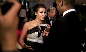 Actress Kim Kardashian speaks during an interview as she arrives for the White House Correspondents' Association (WHCA) dinner in Washington, D.C. in 2010.