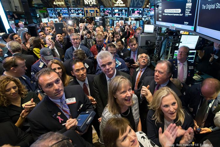 The Container Store Chairman and CEO Kip Tindell (center), President Melissa Reiff, CMO Sharon Tindell and CFO Jodi Taylor rang the opening bell at the New York Stock Exchange and watched as stock soared on their first day of trading Nov. 1.