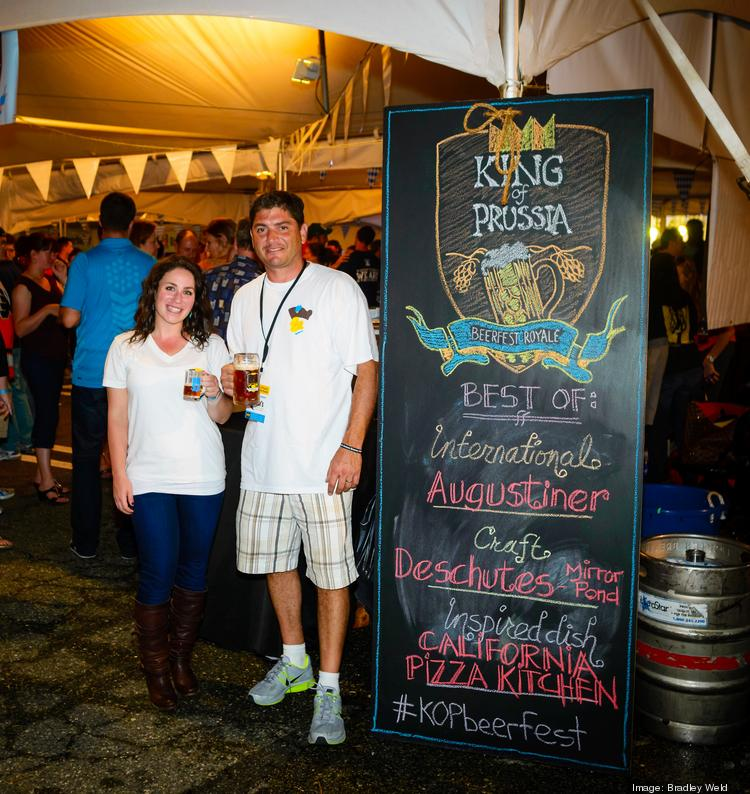 Brooke Hersh (left), marketing coordinator, and Eric Goldstein, executive director at King of Prussia District, at the King of Prussia Beerfest Royale, which raised money for the nonprofit.