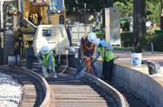 A jackhammer is used to secure the track and ties in place in Winter Park.