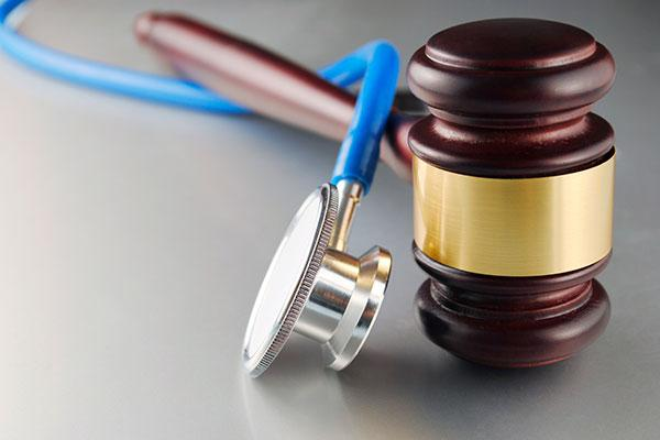 The University of Cincinnati has agreed to pay $2.3 million to a Clinton County fruit farmer to settle a 2007 lawsuit that alleged she became a paraplegic from an infection as a result of a delayed diagnosis involving UC doctors at a teaching hospital in Wilmington.