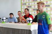 Gate City FC Head Coach Brian Japp, center, in red, talks with reporters Monday. Joining Japp on the dais were, from left, team President Justin Cox, Gary Ross, the public address announcer at the Greensboro Coliseum, and David Ulmsten, general manager for the team. At right and wearing a Gate City prototype uniform is Bruce Olivier, currently a player at Milligan College in Tennessee who formerly played for Wesleyan Christian Academy in High Point.