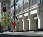 End of an arcade: Biz-strangling overhang on New York Avenue will be enclosed
