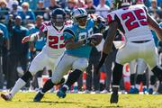 Panthers wide receiver Steve Smith turns upfield after making a catch, while defenders Robert Alford and William Moore close in.