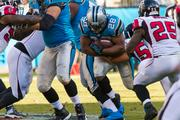 Panthers running back Jonathan Stewart, playing in his first game of the season after an extended injury, braces for a collision with Falcons safety William Moore.