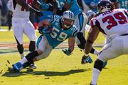 Panthers linebacker Luke Kuechly tries to keep his footing after making an interception.