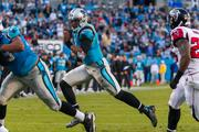 Panthers quarterback Cam Newton rushes toward the end zone.