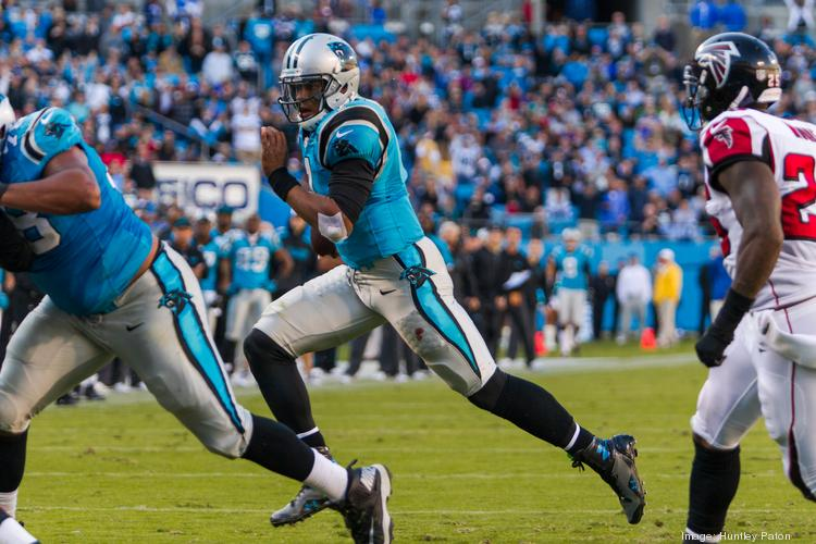 Carlina Panthers quarterback Cam Newton rushes toward the end zone Sunday versus the Atlanta Falcons. The Panthers defeated the Falcons 34-10 at Bank of America in Charlotte.