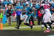 Panthers quarterback Cam Newton scores on a keeper.