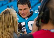 Panthers linebacker Luke Kuechly has smiles for the media after his team gets its fifth win of the season.