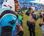 Panthers quarterback Cam Newton is all smiles after his team's fifth win of the season.