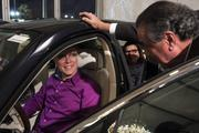 Sabates (right) talks to an attendee at the grand opening of his Bentley Charlotte dealership.