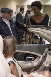 Grand-opening attendees climb inside the luxury cars on the showroom floor at Bentley Charlotte.