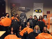 David Weekley Homes marketing department dressed up as Mary Jane candy. Top row (from left to right): Marcie Jones, Donna Marie Jendritza, Melody Martin, Christina Carrillo, Sonia Escamilla, Celeste Rodriguez. Bottom row (from left to right): Aimee Kishell, Jennifer Herrmann, Natalie Harris Brown, Sarah Leone, Ann Holdsworth.