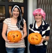 20K Group's Account Executive Amy Carl (left) and Research Assistant Carolyn Shaffer pose with their pumpkins.