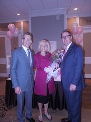Living in Pink held its 10th annual luncheon at Fairmont Washington, D.C., Georgetown on Nov. 1. Mark Andrew, regional vice president and general manager, far left, and Bob Mikolitch, director of catering, presented Michele Conley, founder and chairman of Living in Pink, with a bouquet of pink roses in honor of the occasion.