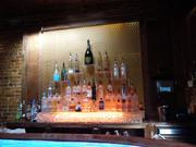 Liquor bottles and colorful lights line the bar at Club 23 in downtown Orlando.