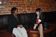 Sherry Paramore, area director at the United Negro College Fund, chats with 2013 Women Who Mean Business honoree Megan Costa DeVault of Akerman Senterfitt.