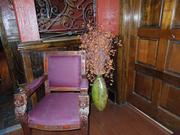Colorful furniture and dark wood doors accent the rustic atmosphere at Club 23 in downtown Orlando.