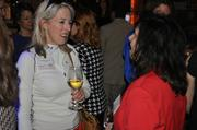 Elizabeth Dvorak of Workscapes networks with Diana LaRue of Appleton Creative during the 2013 Women Who Mean Business pre-reception.