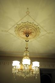 The historic Governor's Mansion got a facelift with new exterior lighting and restoration of the third floor. This is a detail of a chandelier in the ballroom.