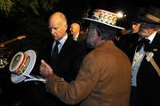 California Gov. Jerry Brown looks at a hat from his father Pat Brown's gubernatorial campaign. Pat Brown lived in the Governor's Mansion, which is now a state park.