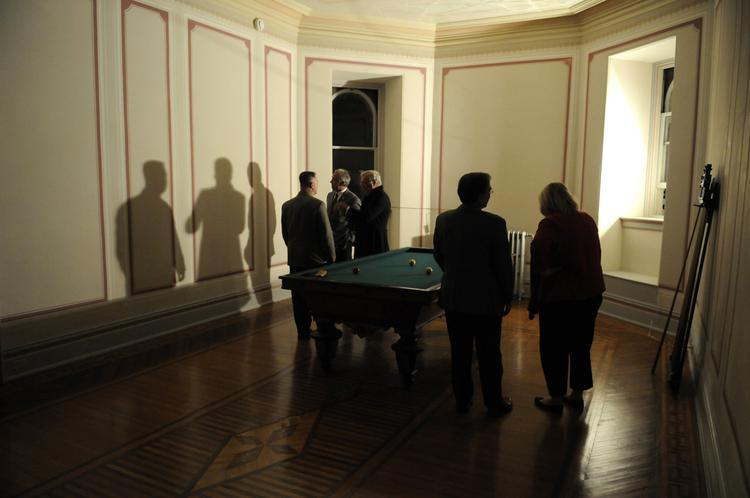 The historic Governor's Mansion got a facelift with new exterior lighting and restoration of the third floor. Visitors stand in the restored billiard room.