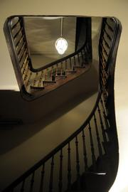 The historic Governor's Mansion got a facelift with new exterior lighting and restoration of the third floor. This stairway leads to the cupola.