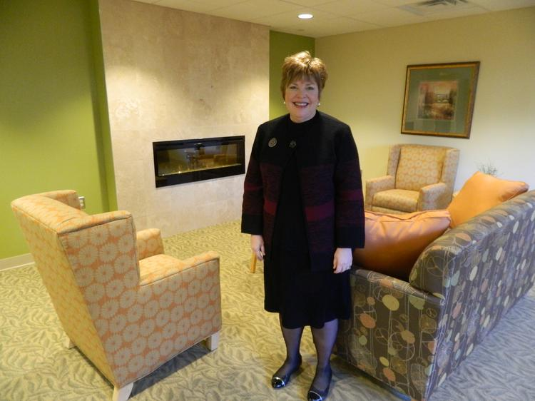 Abramson Center CEO Carol Irvine in the adult medical day services center's living room.