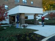 Workers finishing entrance to the adult medical day services center in Northeast Philadelphia.
