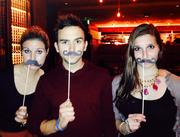 To kick off this year's Movember, an annual event that encourages men to grow mustaches during the month of November to raise awareness of prostate cancer and other male cancer and associated charities, Del Frisco's Grille hosted a 'Stache Bash on Nov. 1. From left, Sarah Shriver of Linda Roth Associates, Tommy McFly of Fresh FM 94.7 and Avery Lewis of Linda Roth Associates.