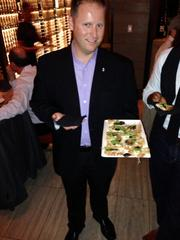 "General Manager Tim Donah offered guests a sample of the ""Mo-Shroom"" flatbread."