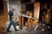 Potter Mark Connolly walks past the entrance of the kiln at the Red Wing Pottery Co. in Red Wing.