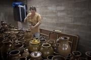 Potter Scott Keith inspects pottery pieces just out of the kiln at the Red Wing Pottery Co. in Red Wing.