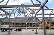 View of the Winter Park Train Station main building through the framework of a platform cover.
