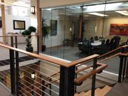 A conference room overlooks the upper landing of the staircase at law firm Gevurtz Menashe.