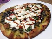 Pesto and Buffalo Mozzarella flatbread with tomato, basil and balsamic reduction