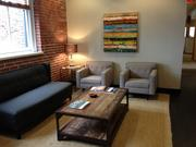 Exposed brick and natural light warm the offices of law firm Gevurtz Menashe, which recently moved to Old Town/Chinatown from U.S. Bancorp Tower.