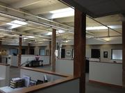 Exposed roof trusses provide drama at law firm Gevurtz Menashe's new offices in Old Town/Chinatown.