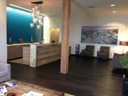 Generous use of wood, coupled with modern accents, provides a welcoming atmosphere at Gevurtz Menashe's reception desk.