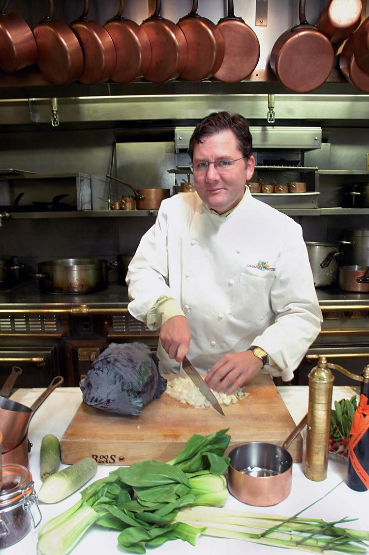 Chef Charlie Trotter poses in the kitchen of his restaurant, Charlie Trotter's, in Chicago in 2005.
