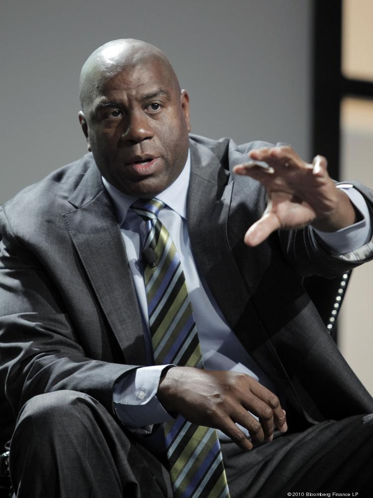 """Earvin """"Magic"""" Johnson, chairman and chief operating officer of Magic Johnson Enterprises Inc., speaks at the Ernst & Young Strategic Growth Forum in Palm Springs, California, U.S., on Tuesday, Nov. 9, 2010. The five-day conference brings together 1,500 business leaders for seminars on entrepreneurial  strategies. Photographer: Francis Specker/Bloomberg *** Local Caption *** Earvin Johnson"""