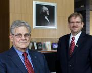 """Eaton """"Ed"""" Lattman, CEO at HWI, left, and Alexander Cartwright, UB's vp for research and economic development."""