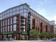 The planned mixed-use development at 600 H St. NE from Insight Property Group, featuring a Whole Foods market.