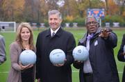 Big 12 Commissioner Bob Bowlsby, center, said the new tournament field at Swope Park Soccer Village features the best stand of turf grass he has ever seen grown in 120 days. That's how long the city had to get the field designed and built after learning that the Big 12 Women's Soccer Championship tournament would take place there starting on Wednesday.