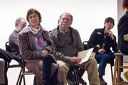 Local photographer and TLF board member Deborah Triplett (left) and founder member Byron Baldwin (center) listen to remarks at the recent members meeting. Also pictured is Mitchell Kearney (right, back row), another photographer and member of the organization.