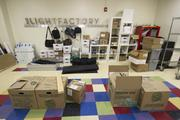 Much of the organization's property remains in boxes after being moved from Spirit Square uptown over the weekend.